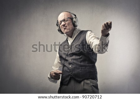 Man listening to music and playing air guitar - stock photo