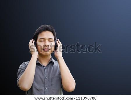 Man listening to music with headphones - stock photo