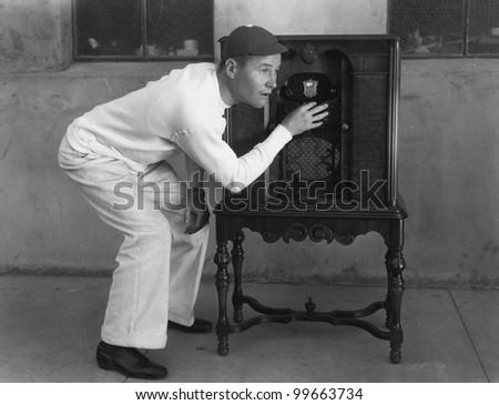 Man listening to radio - stock photo
