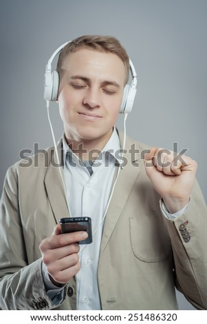 man listens music with headphones - stock photo