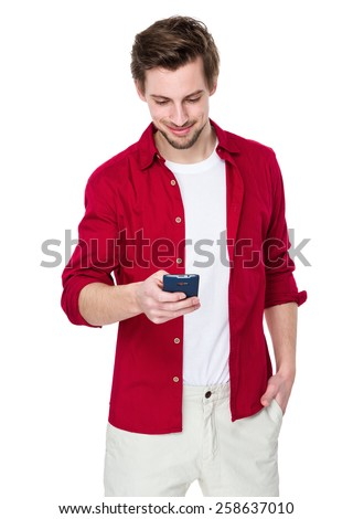 Man look at cellphone - stock photo