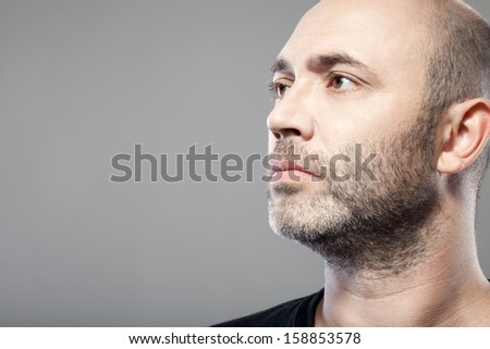 man look into the distance isolated on gray background with copyspace