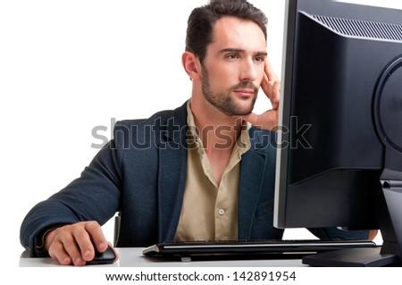 Man looking at a computer screen, thinking about the job at hand - stock photo