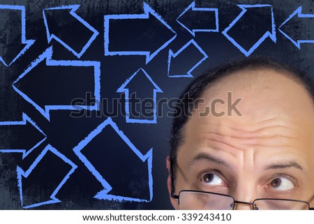 Man looking at arrows pointing in every direction expressing multiple choices and dilemma. Grunge background.  - stock photo