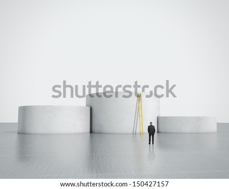 man looking at empty podium with ladder