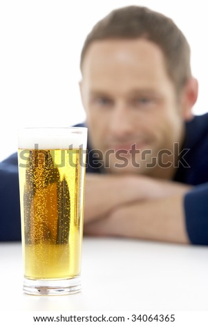 Man Looking At Glass Of Beer - stock photo