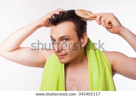 man looking at gray hair