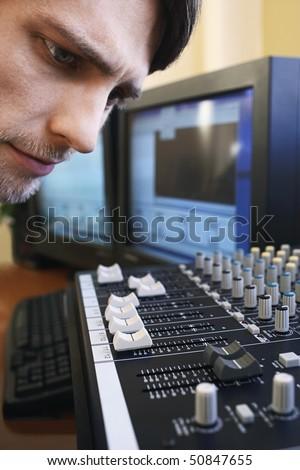 Man looking at mixer, close-up. - stock photo