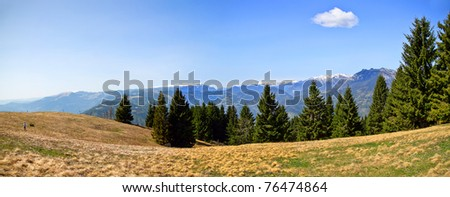 man looking at mountain landscape - stock photo