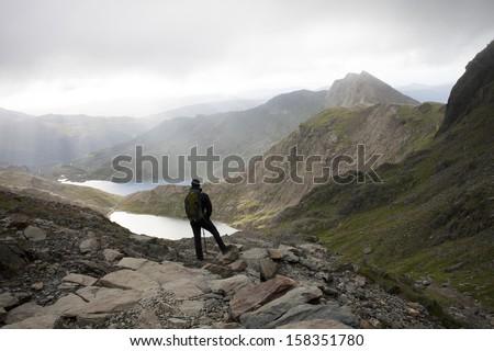 man looking at mountain scene, snowdon - stock photo