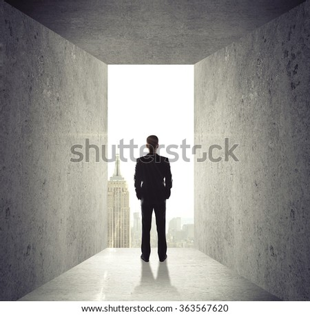 man looking at opened concrete wall to city - stock photo