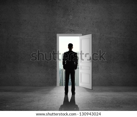 man looking at opened door - stock photo