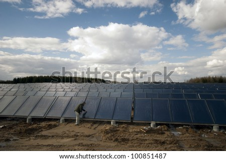 Man looking at solar heating plant building site