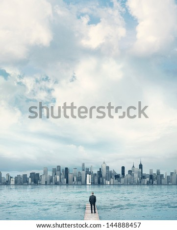 man looking at the city on a horizon