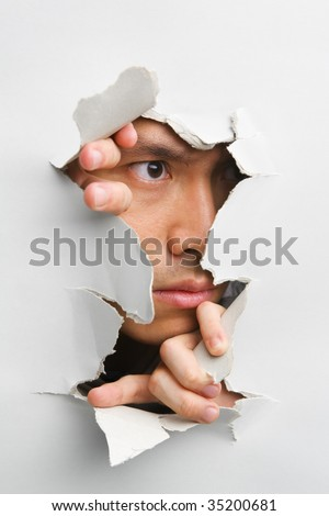 Man looking away from cracked wall - one of the breakthrough series - stock photo
