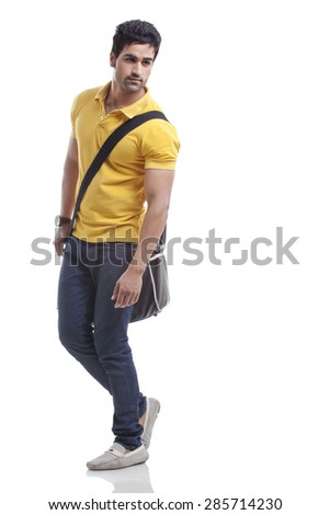 Man looking away while walking over white background - stock photo