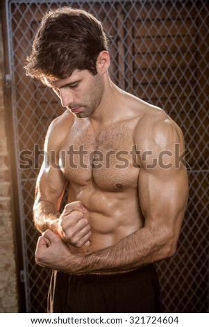 Man looking down with clenched fist at the gym