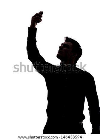 Man looking for network in silhouette isolated over white background  - stock photo