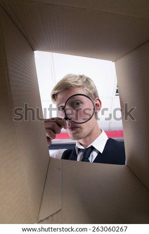 man looking in a box