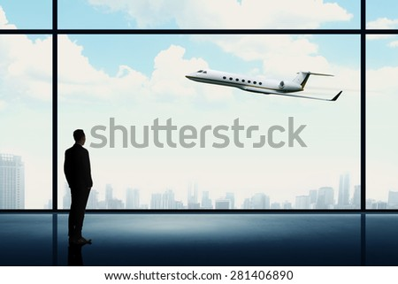 Man looking on the private jet. Business career conceptual - stock photo