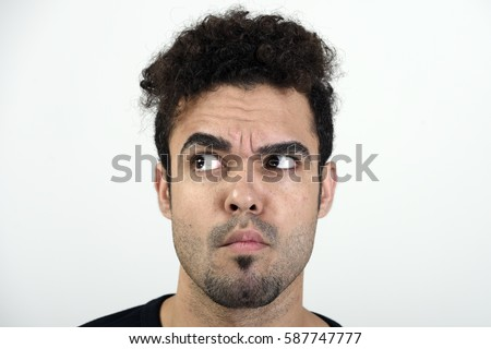 Man looking right with a raised eyebrow
