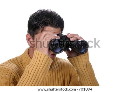 Man looking through binoculars at something