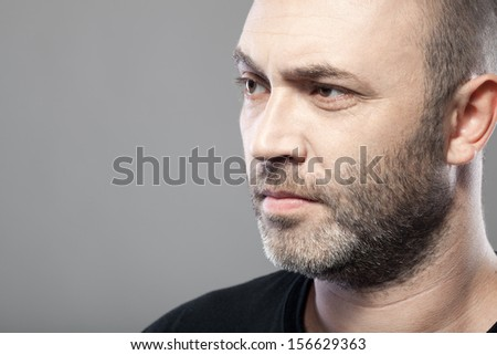 man looking to the left isolated on gray background with copyspace