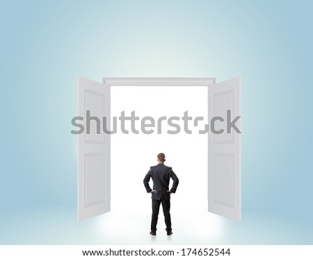man looking up at a door with empty space