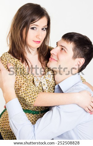 Man looking up to a beautiful woman. Couple hugging. - stock photo