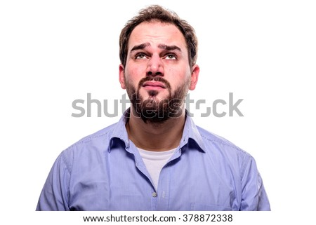 Man looking up with his eyes, hoping expression - stock photo