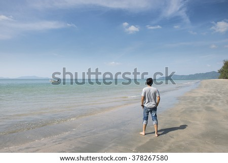 Man looks at the sea