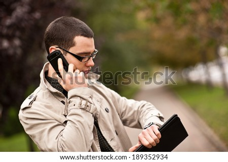 Man looks at the watches outside - stock photo