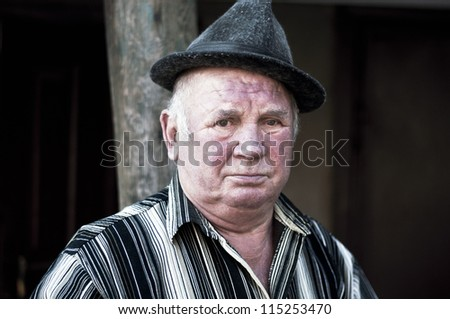 man looks at you with suspecting - stock photo