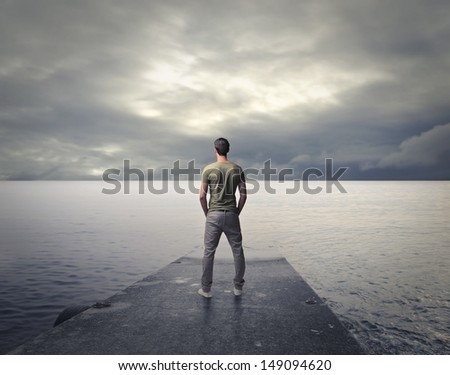 man looks cloudy landscape
