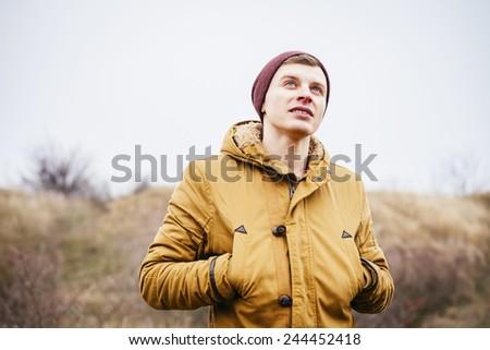 man looks into the horizon - stock photo