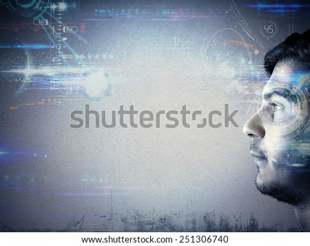 Man looks the technology of the future - stock photo