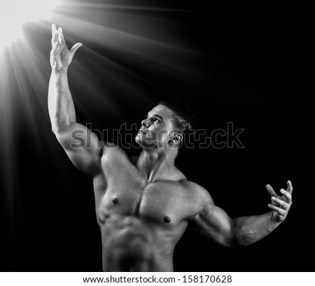 Man looks up to a bright lite. - stock photo