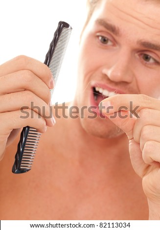 man loosing his hair - stock photo