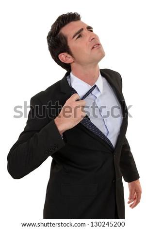 Man loosing tie - stock photo