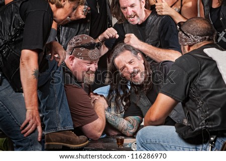 Man loses an arm wrestling match with tough gang member
