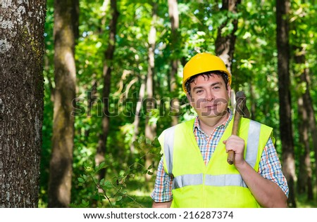 man lumberjack in the forest - stock photo