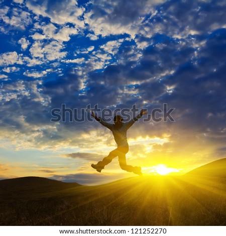man lumping on a sunset background - stock photo