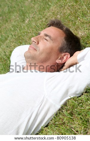 Man lying down in park