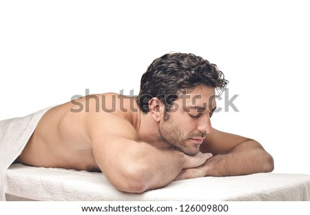 Man lying on a massage table - stock photo