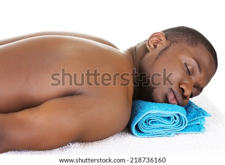 Man lying on a massage table at spa