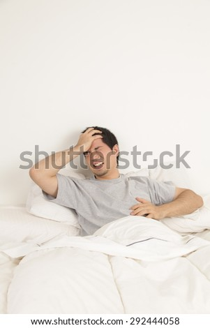 Man lying with headache