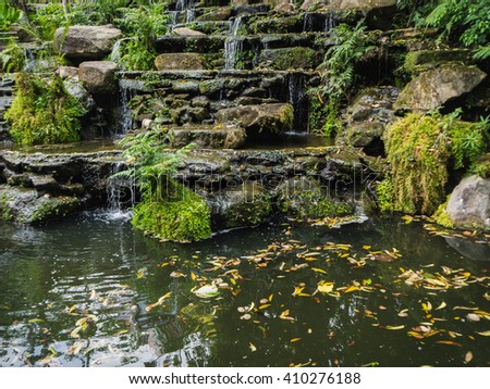 Man made garden to imitate the waterfall in restaurant, Rayong Thailand, soft focus - stock photo