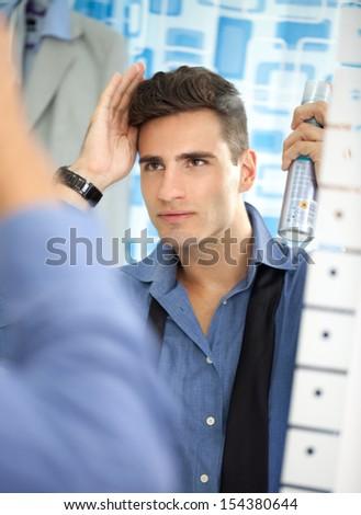 Man make hairstyle hair spray - stock photo