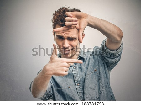 Man makes a frame with his fingers - stock photo