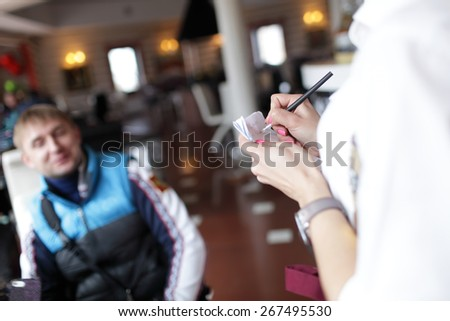 Man makes an order in a restaurant - stock photo